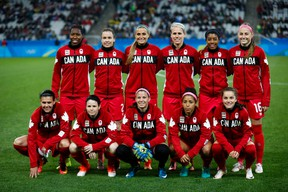 Players on Canada's women's soccer team pose before their match against France at the Rio Summer Games on Aug. 12. (GETTY IMAGES)