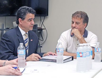 U.S. consul general Juan Alsace, centre, chats with North Bay & District Chamber of Commerce executive director Patti Carr and Ed Valenti of Century 21, Tuesday, at the chamber office. Alsace said there are investment opportunities on both sides of the border. PJ Wilson/The Nugget