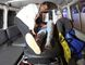 A wounded person is treated in an ambulance after an attack on the campus of the American University in the Afghan capital Kabul on Wednesday, Aug. 24, 2016. (AP Photo/Rahmat Gul)