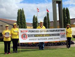 Participants in the car tour make a stop in front of Winkler city hall. The tour sought to raise awareness of human rights abuses, including organ harvesting, that the Chinese government is accused of. (Cassidy Dankochik/The Winkler Times)