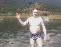 Wayne Strach covered head to toe in grease as he began his world record swim on Aug. 8. He ended up having to stop after about 40 kilometres after he became separated from his support boat.