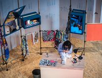 An artisan works with silk at a previous Hermes at Work festival. Hermes Canada photo