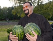 US actor Steven Seagal who has been recenlty granted Serbian citizenship, holds two water melons during his meeting with the Belarus President at his residence of Drozdy, outside Minsk, on August 24, 2016. / AFP PHOTO / BELTA / Stasevich Andrei  OlegovichSTASEVICH ANDREI  OLEGOVICH/AFP/Getty Images