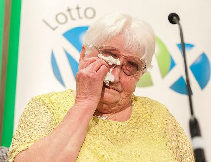Mary Wernicke becomes emotional during a cheque presentation at DoubleTree hotel in Regina, Sask., on Thursday Aug. 25, 2016. Wernicke won $60 million on the Aug. 12 Lotto Max draw. THE CANADIAN PRESS/Michael Bell