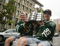 Christian Dvorak and Mitch Marner hoist the Memorial Cup as they are carried down Queens Avenue towards Budweiser Gardens as part of the Knights parade in London, Ont. on Thursday August 25, 2016. Mike Hensen/The London Free Press/Postmedia Network