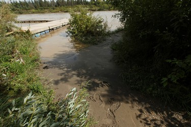 Footprints are seen in mud revealed by receding water on the North Saskatchewan River in Edmonton, Alberta on Thursday, August 25, 2016. The City of Edmonton says river levels have crested. Ian Kucerak / Postmedia