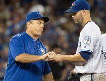 Toronto Blue Jays manager John Gibbons takes the ball from starting pitcher J.A. Happ during the sixth inning of a game against the Los Angeles Angels in Toronto on Aug. 25, 2016. (THE CANADIAN PRESS/Fred Thornhill)