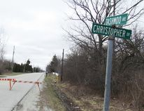 Barricades were up on Tashmoo Avenue, from Christopher Street to LaSalle Line, on Saturday March 26, 2016 on the Aamjiwnaang First Nation at Sarnia. The body of Jonathan Patrick Pike, 26, of Sarnia was found the previous day in a wooden area west of Tashmoo Avenue. A third person sought in the murder investigation was arrested this week in Kitchener. File photo/Sarnia Observer/Postmedia Network