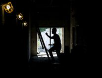 Tim Miller/The Intelligencer A worker gets ready to climb a ladder in the unfinished hallway of Trent River Public School on Wednesday August 24, 2016 in Trenton, Ont. The new school is expected to open its doors January, 2017.