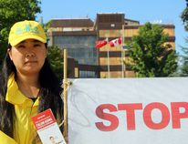 (Charlie Pinkerton/Special to The Sault Star) Yue Zhao at a plea for help staged by Falum Gong practitioners in front of City Hall on Friday.