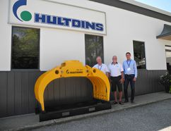 Gerry Mallory (left) and Rick Gordon pose for a photo with Johan Ridderstrale, owner and CEO of parent firm, Hultdins System AB of Sweden. (Michael-Allan Marion/The Expositor )