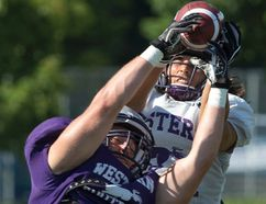 Chris Bunting, front, attempts to pick off a pass intended for Justin Sanvido during Western Mustangs football practice at TD Stadium on Friday. (CRAIG GLOVER, The London Free Press)