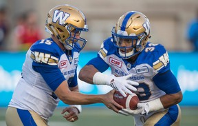 Winnipeg Blue Bombers quarterback Matt Nichols hands off to running back Andrew Harris as they face the Montreal Alouettes during first quarter CFL football action Friday, August 26, 2016 in Montreal. THE CANADIAN PRESS/Paul Chiasson