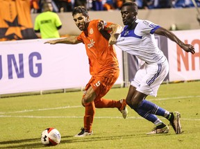 FC Edmonton striker Tomi Ameobi, right, battles for the ball with Puerto Rico FC defender Ramon Soria in North American Soccer League play Saturday, Aug. 6, 2016 in Puerto Rico. Ameobi scored the only goal of the game in a 1-0 win for FC Edmonton.