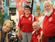 Cathie Blake (far left) buys a raffle ticket to put Santa on a new sleigh for the Sarnia Kinsmen Club's annual Santa Claus parade. From left are Blake and Karen Ferguson, Jack Struck, Ace Concordia and six-year-old Ella Jones. Photograph taken Sunday, Aug. 28, 2016 at Sarnia, Ontario (Neil Bowen/Sarnia Observer)