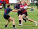 Sarah Odenbach, right, of the Grande Prairie Sirens, hands off the ball before being tackled against the Edmonton Clanswomen in Edmonton Rugby Union Division I female play on Saturday August 27, 2016 at Macklin Field in Grande Prairie, Alta. The Clanswomen won 39-0. Logan Clow/Grande Prairie Daily Herald-Tribune/Postmedia Network