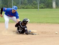 Cody Jackson, of the Sudbury Nickels, slides safely into second base as the throw from the catcher eludes Timmins Melissa Kelly Dance Academy Mets short stop Jamie Dallaire during the second inning of an exhibition game at Fred Salvador Field on Saturday afternoon. After dropping Game 1 of the three-game set 6-2 Friday night, the Mets rebounded to post an 11-3 victory on Saturday. THOMAS PERRY/THE DAILY PRESS