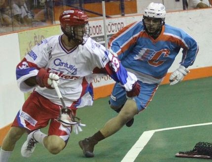 Peterborough Lakers' Bryce Sweeting gets away from Austin Staats, of the Six Nations Chiefs, during Game 4 of the Major Series Lscrosse final on Sunday in Ohsweken. PHOTO BY SIX NATIONS CHIEFS