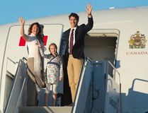 Prime Minister Justin Trudeau, his wife Sophie Gregoire, and daughter Ella-Grace wave as they board a government plane in Ottawa, on Aug. 29, 2016. (THE CANADIAN PRESS/Adrian Wyld)