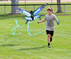 """The term """"go fly a kite"""" was taken literally for a few kids, including Jack Bree, 9, last Wednesday afternoon, Aug. 24, who gathered at the open ball diamonds at Keterson Park to try and take advantage of the soothing summer wind. Unfortunately, the winds were intermittent and the kids did more running than flying, but a few managed to sustain their flights for more than a few seconds. ANDY BADER MITCHELL ADVOCATE"""