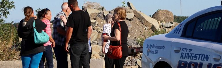 Family members of a suspected drowning victim gather at a quarry in Kingston east Monday. Ian MacAlpine/The Whig-Standard