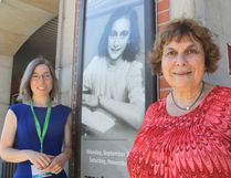 <p>Kimberly Sutherland Mills, left, and Joche Katan stand in front of a poster at the downtown branch of the public library in Kingston, Ont. on Monday, August 29, 2016, announcing a travelling exhibit on Anne Frank will be coming in September. Michael Lea The Whig-Standard Postmedia Network
