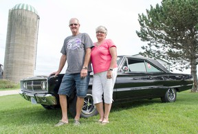 Roy, left, and Marion Taylor stand in front of their new 1967 Dodge Coronet 500 that they won during this year's Moparfest in New Hamburg, Ontario. (Darryl Coote/Reporter)