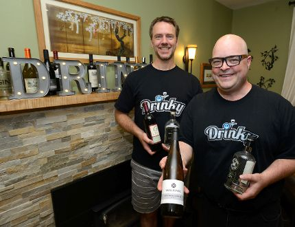 Liam Rice, left, and Bill Wittur, partners in a new business called Drinky.ca a website allowing users to order hard to find wine, liquor, and beer. (MORRIS LAMONT, The London Free Press)