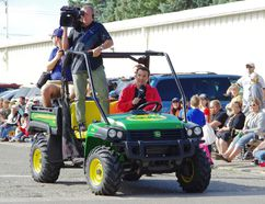 Rick Mercer takes the wheel while filming at Morden's 50th Anniversary Corn and Apple Festival parade Aug. 27, 2016. (Alexis Stockford/The Morden Times)
