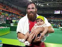 Korey Jarvis poses for a photo with a young Brazilian fan after his wrestling match in Rio on Aug. 20 Photo by: Tanya Casole-Gouveia/CBCOlympics
