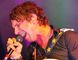 The Trews lead vocalist Colin MacDonald gets a younger than normal Morden Corn and Apple main stage crowd rocking Aug. 27, 2016. (Alexis Stockford/the Morden Times)