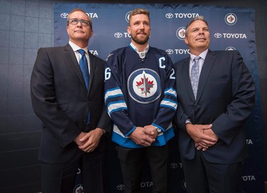 Winnipeg Jets head coach Paul Maurice, left to right, forward Blake Wheeler and general manager Kevin Cheveldayoff pose for a photo after Wheeler was named the new captain of the Jets during a press conference in Winnipeg on Wednesday, August 31, 2016. The team confirmed Thursday, Sept. 7, 2017, the coach and GM have been signed to multi-year contract extensions. THE CANADIAN PRESS/David Lipnowski