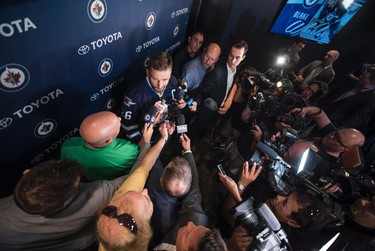 Winnipeg Jets' new captain Blake Wheeler speaks to the media during a press conference in Winnipeg on Wednesday, August 31, 2016. THE CANADIAN PRESS/David Lipnowski