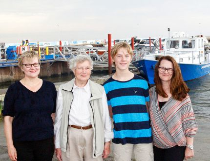 Members of the Nielsen family who donated their boat, the Fylgja (background right), to the Lake Winnipeg Research Consortium where it is now a research vessel. Left to right: Birgit Nielsen, Barbara Nielsen, Maxwell Nielsen, Pauline Nielsen. (Adam Peleshaty, Interlake Publishing, Postmedia Network)