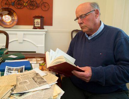 Dennis Alsop Jr. pages through a treasure trove of notes and clippings gathered by his father, a retired OPP Supt. Dennis Alsop. (Free Press file photo)
