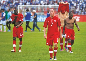 A shell-shocked Iain Hume walks off the pitch following Canada's 8-1 loss to Honduras in a World Cup qualifier at San Pedro Sula on Oct 16, 2012. (AP)