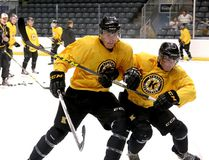 Forward Lawson Crouse, left, battles for the puck with Austin Grzenia during the Kingston Frontenacs training camp at the Rogers K-Rock Centre. (Ian MacAlpine/The Whig-Standard)