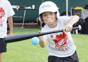 PJ Marshall, of Mitchell, practices bunting during the recent World Children's Baseball Fair (WCBF) in Toyama, Japan. SUBMITTED