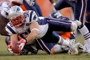Rob Ninkovich of the New England Patriots recovers the ball against the Denver Broncos at Sports Authority Field at Mile High on December 18, 2011 in Denver. (Justin Edmonds/Getty Images)