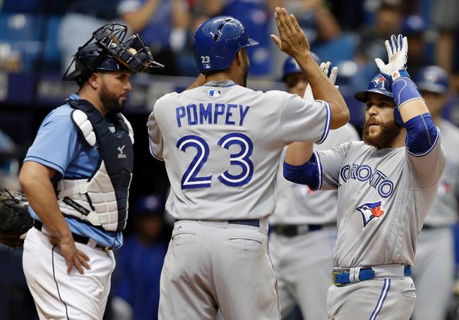 Blue Jays' Russell Martin (right) celebrates with Dalton Pompey after hitting a two-run home run off Rays pitcher Kevin Jepsen during the eighth inning in St. Petersburg, Fla., on Sunday, Sept. 4, 2016. Rays catcher Bobby Wilson (left) looks on. (Chris O'Meara/AP Photo)