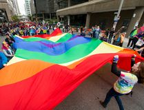 A giant pride flag is walked through the Calgary Pride Parade in the city's downtown core on Sunday, Sept. 4, 2016. (Lyle Aspinall/Postmedia Network)