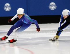 Bennett Winnicky-Lewis, left, of the Peace Wapiti Speed Skating Club, leads teammate Joshua Walterhouse, during the Peace Wapiti Speed Skating Club's annual speed skating meet on Saturday October 31, 2015 at the Coca-Cola Centre in Grande Prairie, Alta. Logan Clow/Grande Prairie Daily Herald-Tribune/Postmedia Network