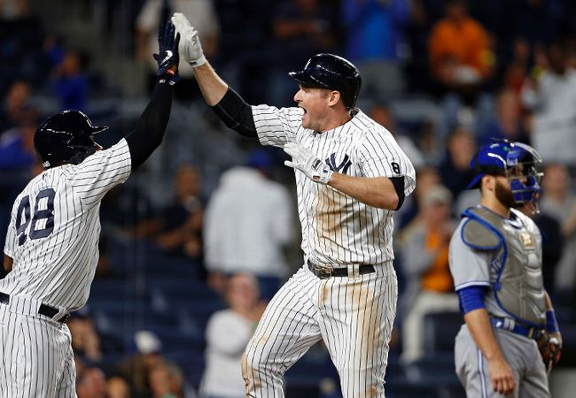 Yankees' Chase Headley celebrates hitting a two-run home run with Eric Young Jr. (48) as Blue Jays catcher Russell Martin looks away during eighth inning MLB action in New York on Tuesday, Sept. 6, 2016. (Adam Hunger/AP Photo)