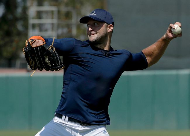 Tim Tebow throws a ball for baseball scouts and the media during a showcase on the campus of the University of Southern California in Los Angeles on Aug. 30, 2016. (Chris Carlson/AP Photo)