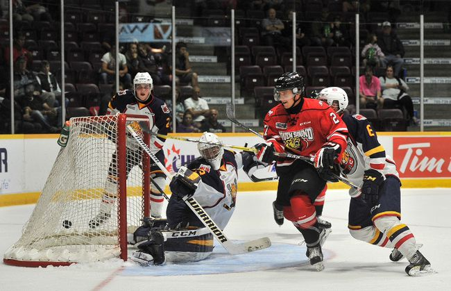Owen Sound Attack forward Aidan Dudas watches as the puck gets past Barrie Colts goaltender Christian Propp during Ontario Hockey Hockey pre-season action on at the Barrie Molson Centre. The Attack would take the win, 3-1. MARK WANZEL/PHOTO