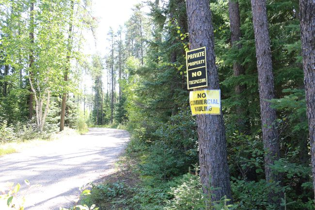 Signs posted on the private road into the Baker Lake area indicate how residents there feel about the application for a gravel pit on a mining claim near their properties. Residents are upset at the possibility that heavy haulage trucks would be introduced to their area in order to facilitate the gravel pit operation. Although city council refused the application, an appeal has been launched with the Ontario Municipal Board to have council's decision reversed.
