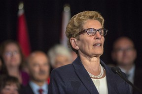 Ontario Premier Kathleen Wynne talks to media at her first press conference after the announcement of a cabinet shuffle at Queen's Park in Toronto, on Monday June 13, 2016. (THE CANADIAN PRESS/Eduardo Lima)