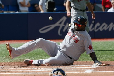 David Ortiz slides  home to score Boston's first run as the Toronto Blue Jays eventually lose to the Boston Red Sox at the Rogers Centre in Toronto, Ont. on Sunday September 11, 2016. Stan Behal/Toronto Sun/Postmedia Network
