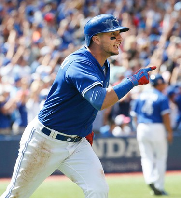 The Jays' Troy Tulowtzki hit s a grand slam home run  in the 3rd inning but the Toronto Blue Jays went on to lose to the Boston Red Sox at the Rogers Centre in Toronto, Ont. on Sunday September 11, 2016. Stan Behal/Toronto Sun/Postmedia Network