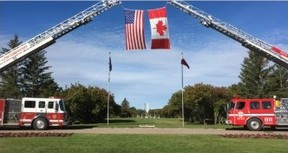Fire trucks display the Canadian and American flags at the International Peace Gardens, where a memorial marked the 15th anniversary of the Sept. 11 attacks in the United States on Sunday, Sept. 11, 2016. (HANDOUT)